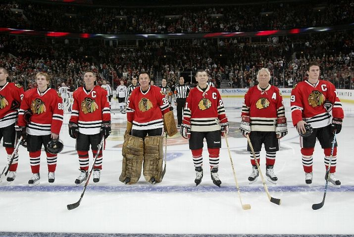Patrick Kane, Denis Savard, Tony Esposito, Stan Mikita, Bobby Hull and Jonathan Toews on the ice together