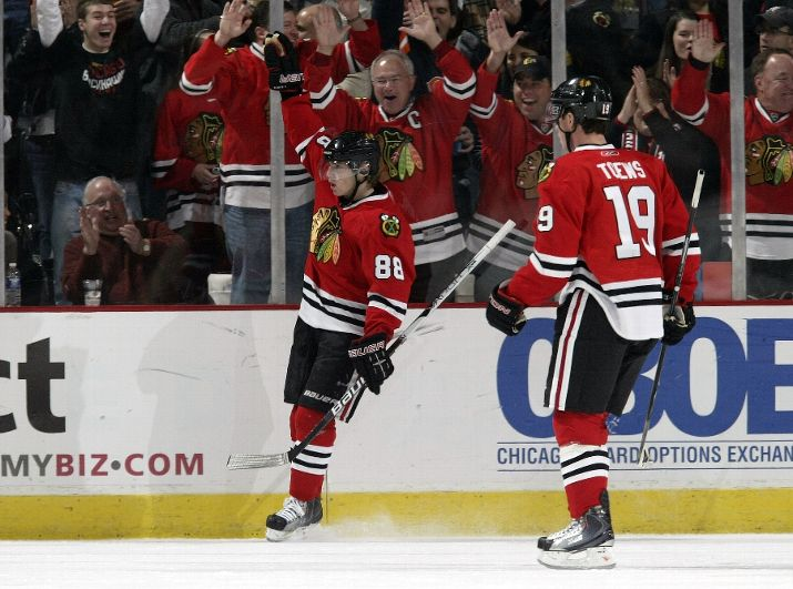 Patrick Kane celebrates his first period goal. He was hurt later, but should be OK for Wednesday.
