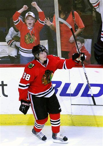 Kaner celebrates ending of a great game.