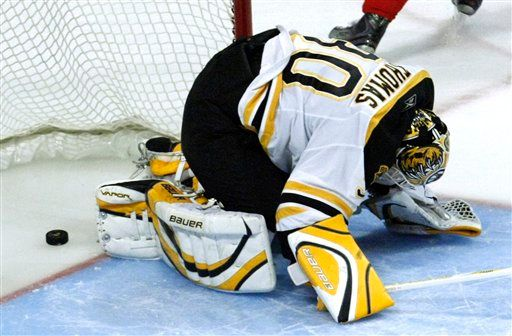 Boston's Tim Thomas helplessly watches Patrick Kane's game winner go in... between his legs.