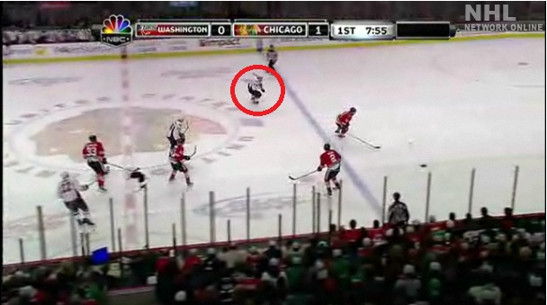 "Here you can clearly see Ovechkin beginning his pursuit of ""the puck."" Campbell clearly has a better line at the puck."