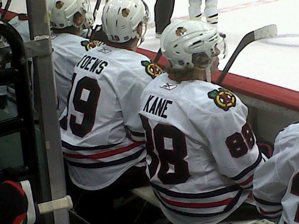 Blackhawks Captain Jonathan Toews, next to Patrick Kane on the bench in Denver