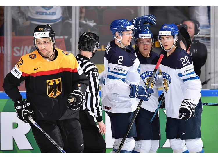 Ville Pokka (#2) and Finland celebrate a goal on Sunday.